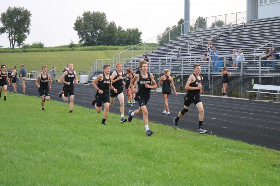 AND THEY'RE OFF - Senior Nathan Brockman and freshman Cooper Jipsen lead a pack of boys at the time trials. These were held on Tuesday, Aug. 21.
