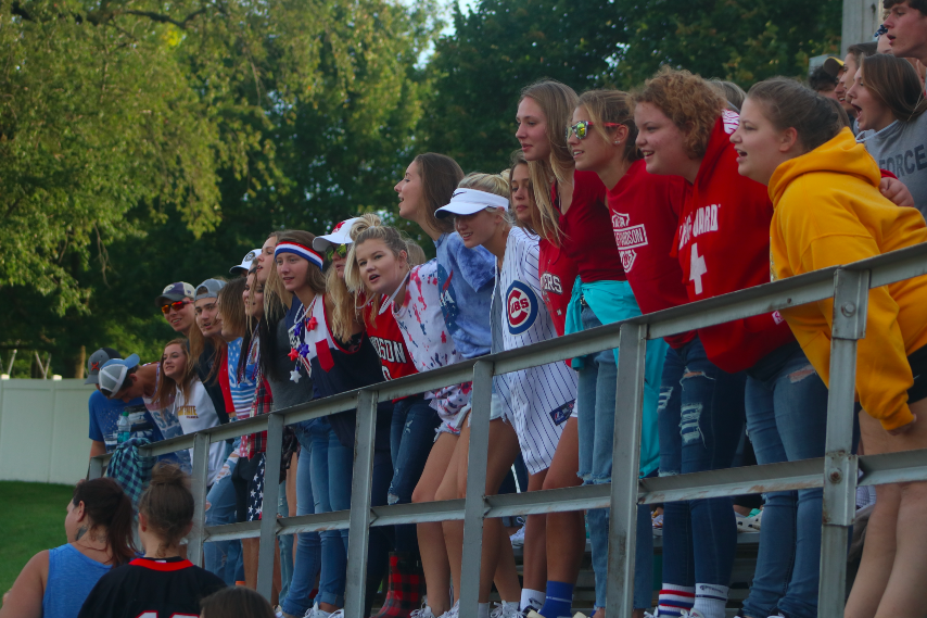 The student sections cheers on the Trojans in their red, white, and blue.