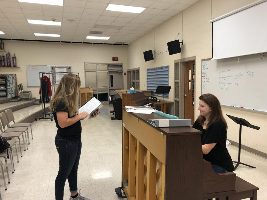 DO+RE+MI+-+Sophomore+Olivia+Engler+practices+with+choir+director+Jennifer+Gaesser.+Students+planning+to+audition+have+to+practice+up+to+13+different+songs.