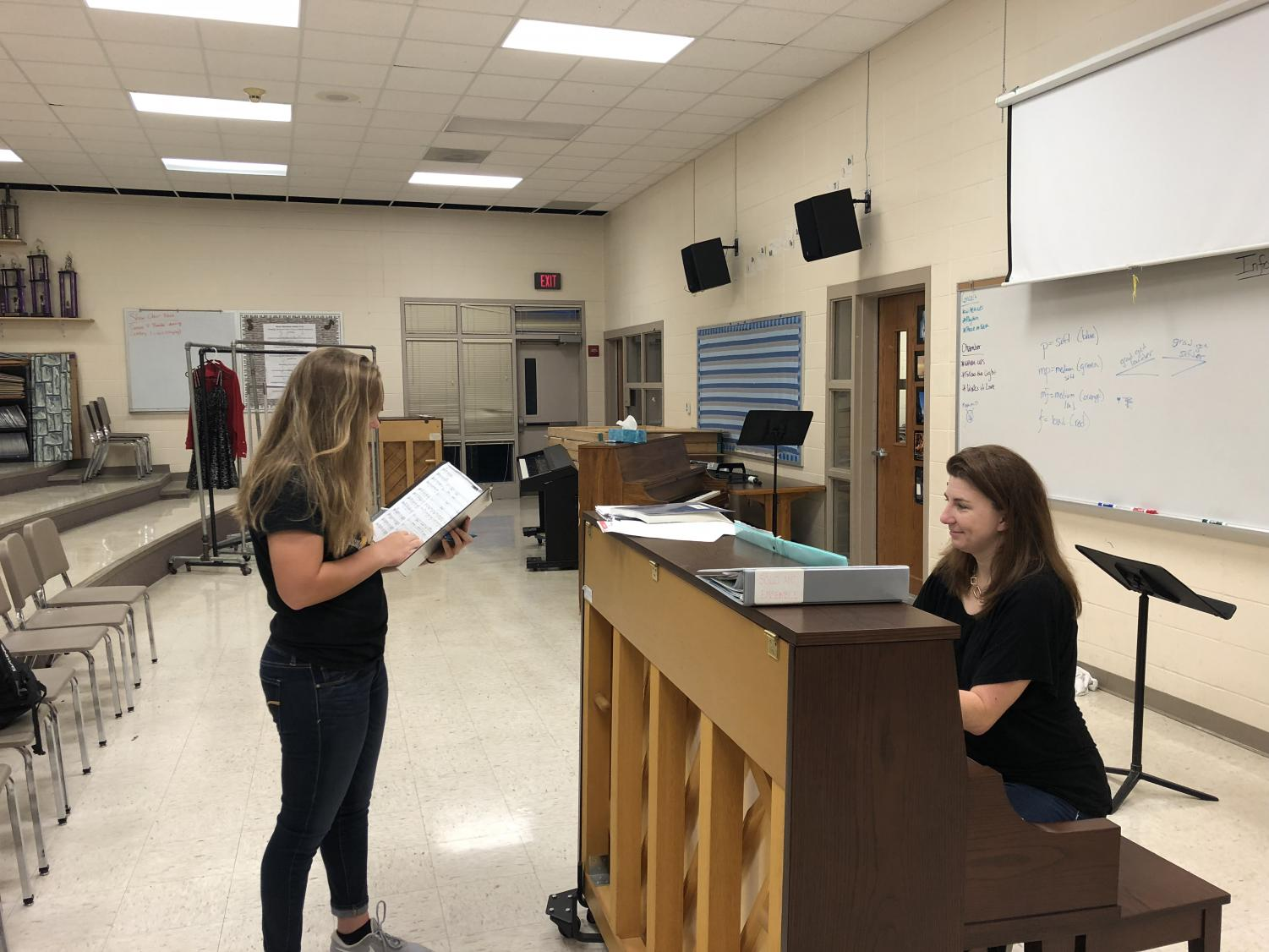 DO RE MI - Sophomore Olivia Engler practices with choir director Jennifer Gaesser. Students planning to audition have to practice up to 13 different songs.