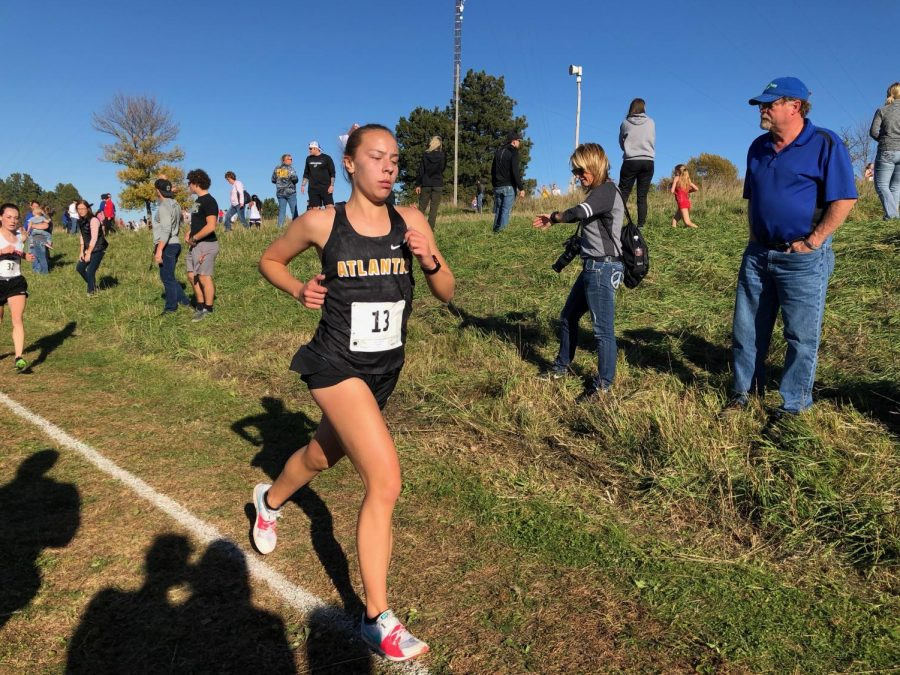 Junior Pluma Pross strides out during the District meet in Glenwood. Pross placed eighth to advance to State with her team.