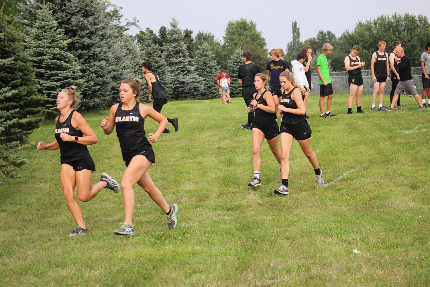 FOLLOW THE LEADER - juniors Corri Pelzer and Kelsie Siedlik and seniors Erin Wendt and Halsey Bailey take off in the first 200 meters of the time trial course. All four have been consistent JV runners for the girls team.