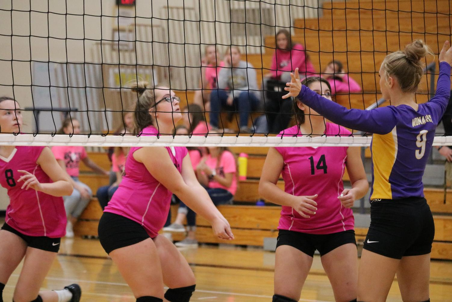 The JV team--decked out in pink--sets the ball up against conference opponent Denison-Schleswig.