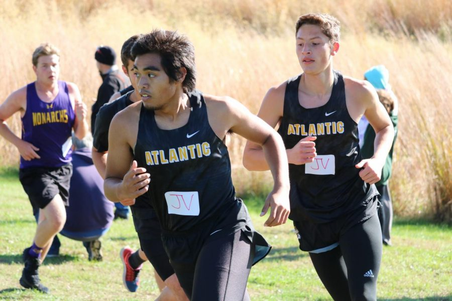 Seniors Brainhart Buliche and Alvin Nantz work together around a corner during their race. Nantz and Buliche finished 17th and 26th, respectively.