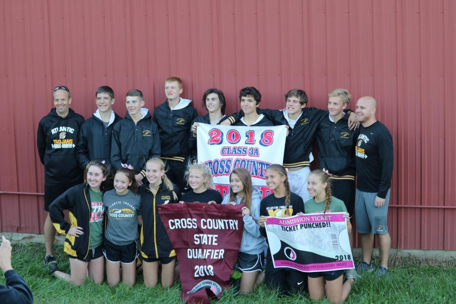 STATEBOUND BABY - Members of the girls and boys cross country teams pose with their banners. This is the first time since 2002 that both teams will be competing at State in the same year.