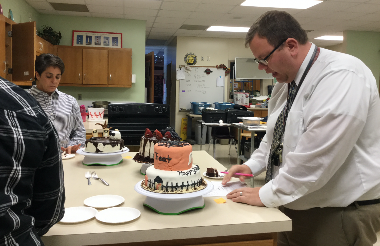 Teachers judge Halloween cakes decorated by Baking and Pastry students.