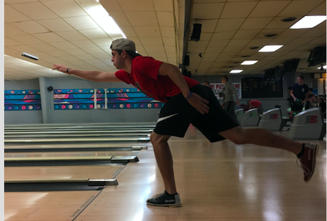 Sam Granner bowls with the football team on Thursday night.