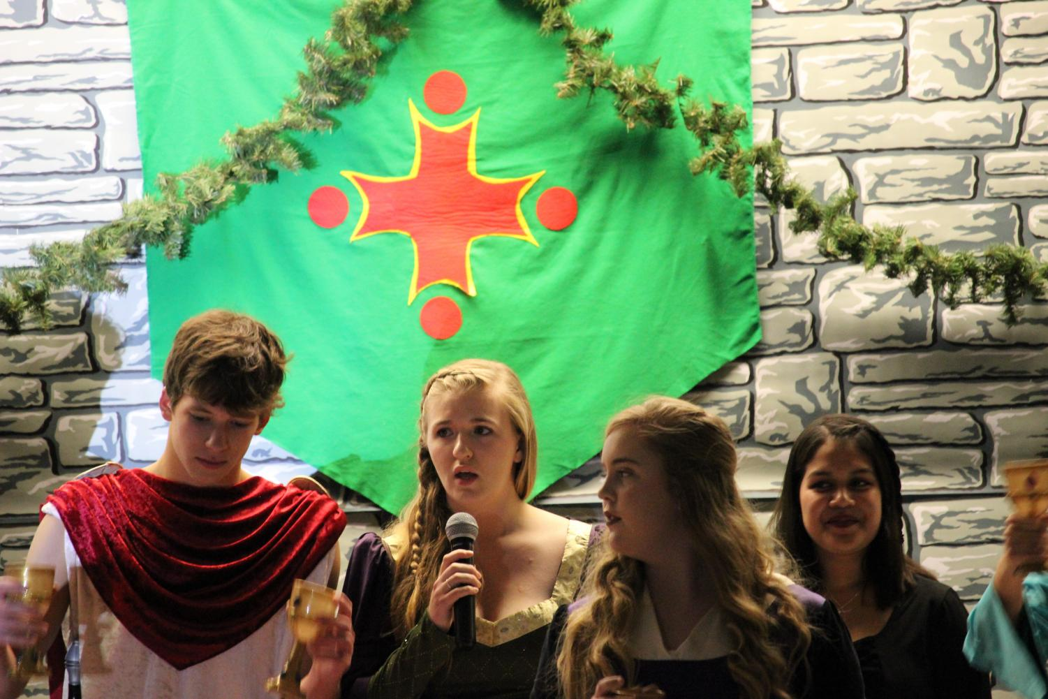 Last year's seniors stand at the head table during the 2017 Madrigal Dinner.