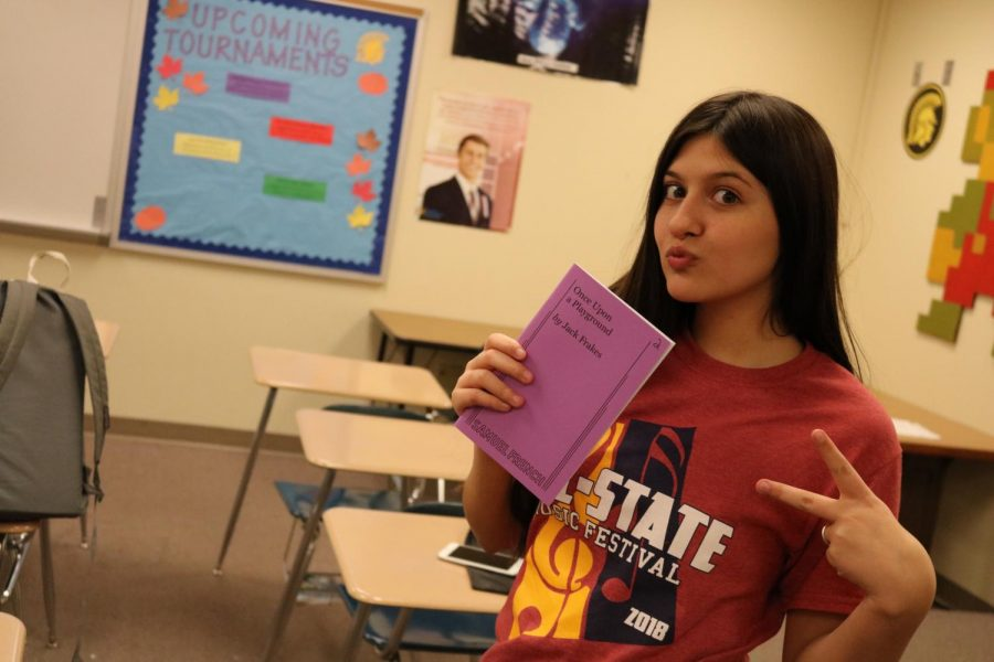 READ+UP+-+Sophomore+Genevieve+Martinez+poses+with+a+book.
