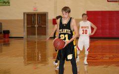 Trojan Boys Basketball Suffers a Tough Loss in Season Opener