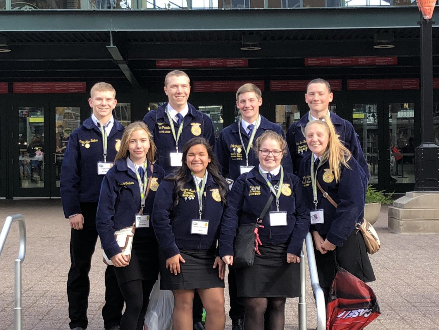 FFA IS LIFE - The seven attending members pose with 2018 graduate Cale Pellett. Pellett was one of two Atlantic alumni to participate in contests at the National Convention this year.