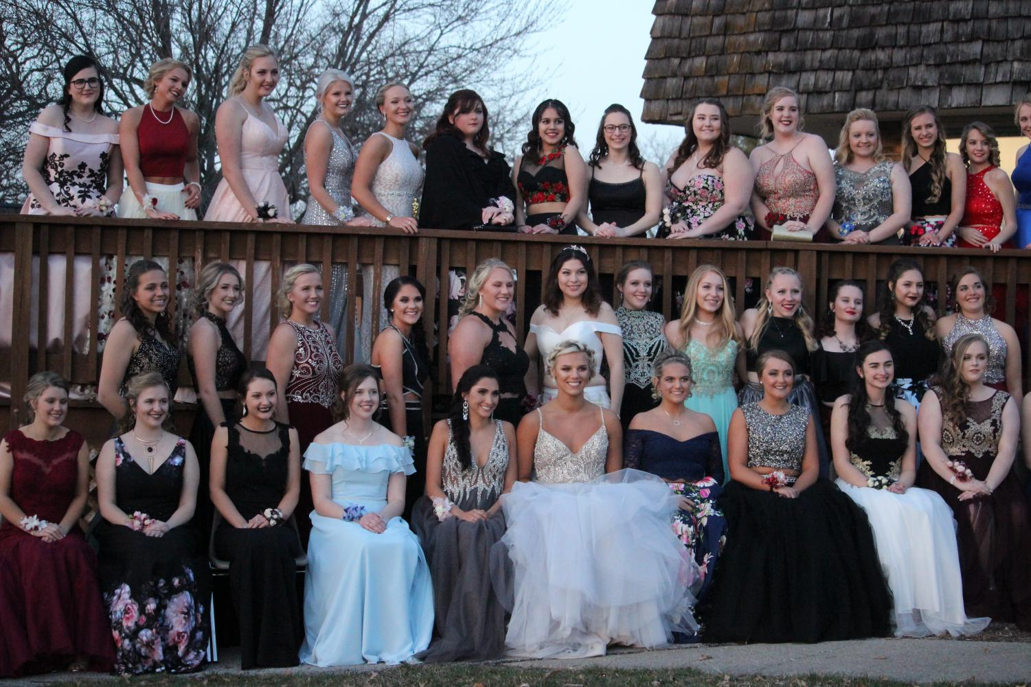 LINE UP - 2018 graduate girls pose for the traditional senior picture. Shown are some examples of dress styles from last year.