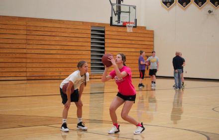 PRACTICE MAKES PERFECT - Trojan basketball began with a week of optional conditioning. Seventeen girls participated.