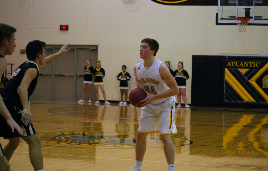 BALL UP - Senior Logan Reilly looks for an opportunity to shoot during the 2017-18 season.