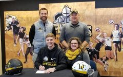IT'S OFFICIAL - Zade Niklasen smiles as he makes his commitment to Dordt College. Niklasen has been a four year letter winner for the Trojan football team and also participated in basketball and track during his years at AHS.