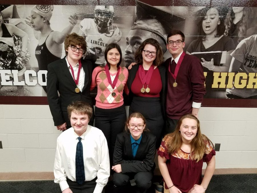 ANOTHER DAY, ANOTHER MEDAL - (top row) Kobe Moss, Genevieve Martinez, Sarah Schorle, Troy Roach, (bottom row) Lane Muell, Carina Birkel and Olivia Engler pose after receiving awards. The Lincoln Railsplitter was the third straight weekend of competing for the AHS speech and debate students.