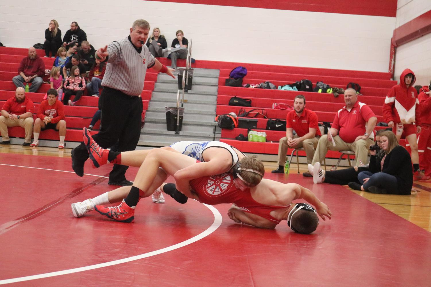 WATCH THE LINE - Senior Chase McLaren edges his way off the mat with an opponent. McLaren ended the night with one pin.