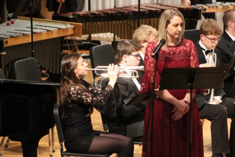 "SWIBA READY -- Junior Erin Barrick gets ready for her upcoming honor bands with a solo at the winter concert while English teacher Emma Bireline narrates the piece called ""The Divine Comedy."""