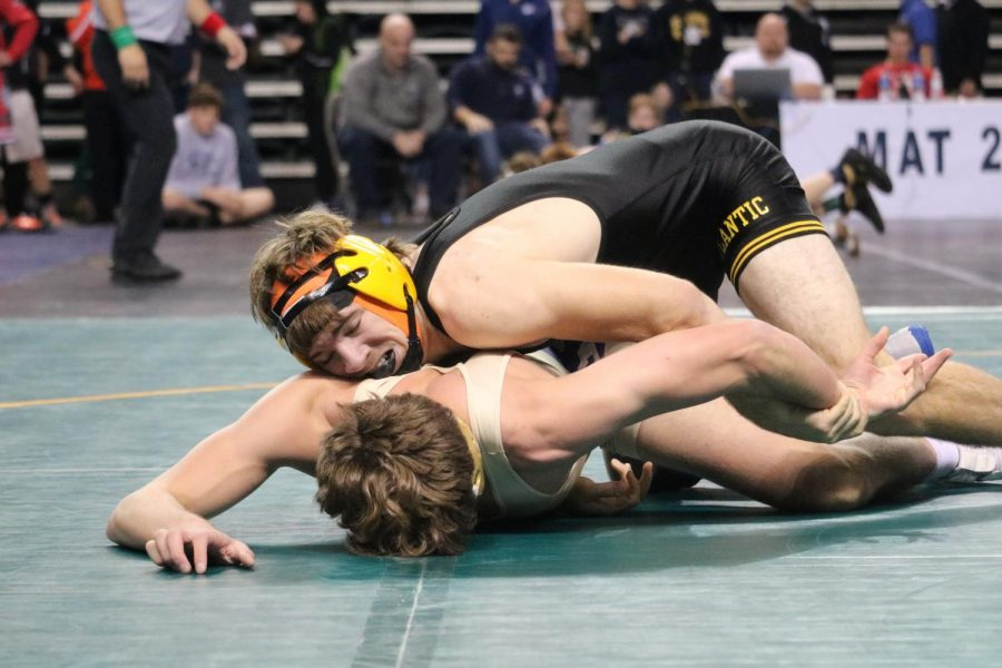 KEEP HIM DOWN - Senior Connor Pellett works hard to hold his opponent on the mat. Pellett was one of two wrestlers to place in the tournament, earning eighth.