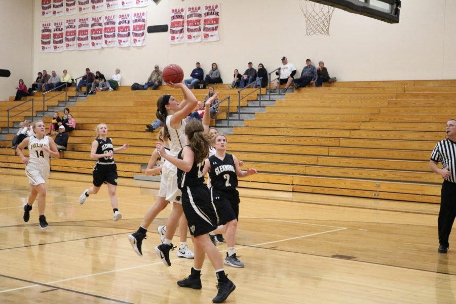Sophomore Alyssa Derby goes up for two against Glenwood. Derby plays on JV and varsity.