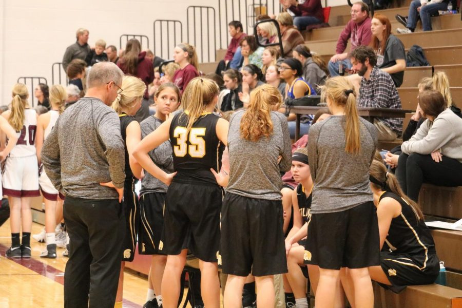 The girls crowd around each other during a timeout during Friday night's game against Shenandoah. The Trojans' record fell to 0-7 after the defeat from the Fillies.