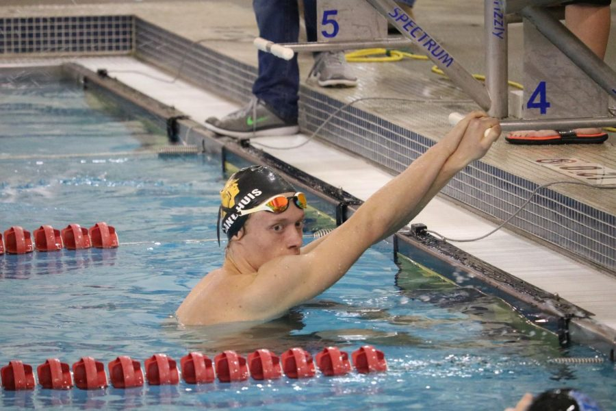 KEEPING A CLOSE EYE - 2018 Clarinda graduate Nik Landhuis watches his competition as they finish the race. Landhuis was the only swimmer to qualify for the State meet last year.