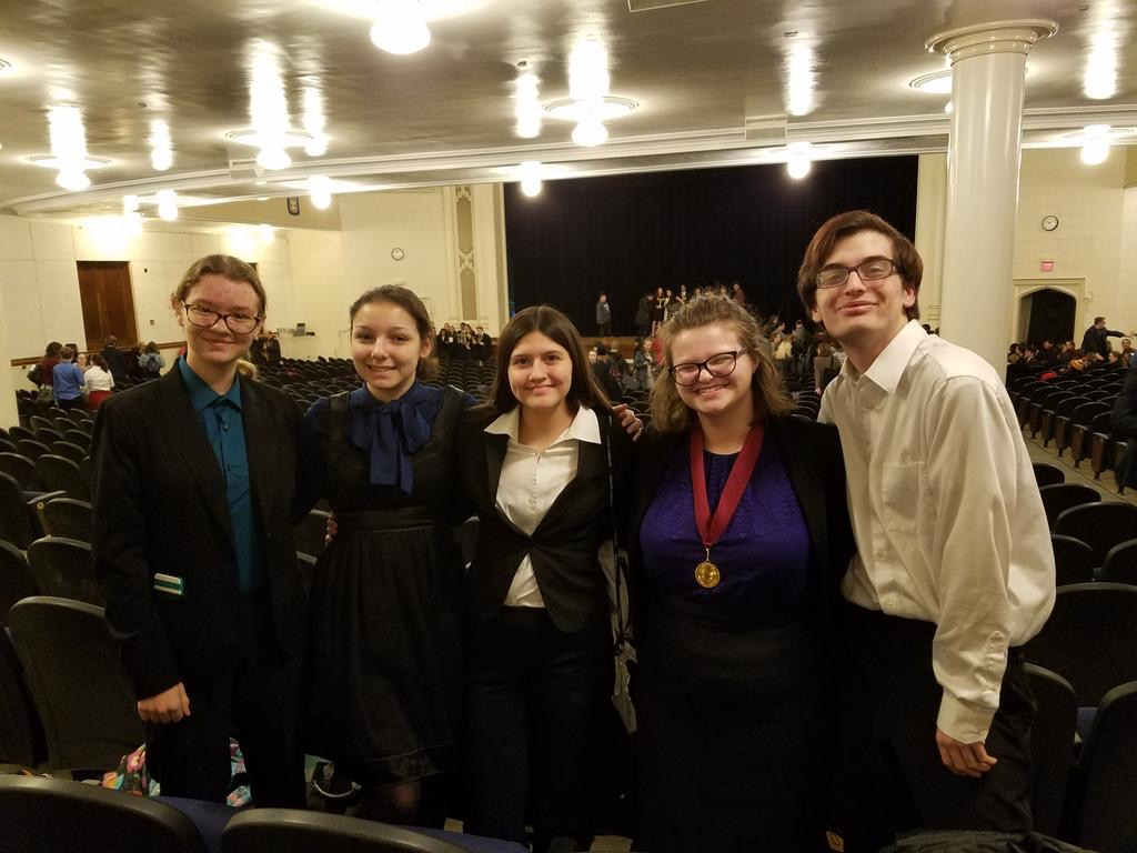 WE'RE READY -- Speech and debate members smile happily after a competition. The district individual speech competition is set for Feb. 23, with many Atlantic students participating.