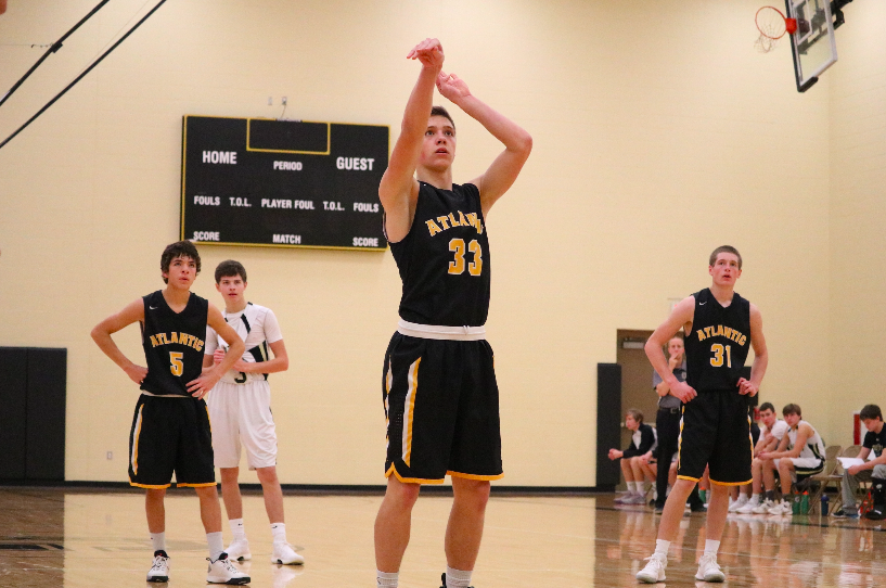 FOCUS IS KEY - Senior Zade Niklasen concentrates as he makes his free throw shot. Niklasen has recently committed to play football at Dordt College.