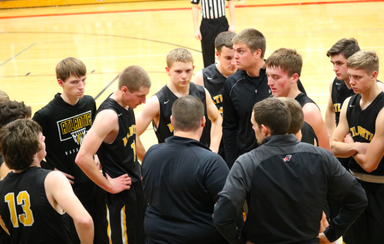 The Atlantic boys pay close attention to Coach Eblings instructions during Friday nights competition. Junior Tyler Moen netted the most points with 18.