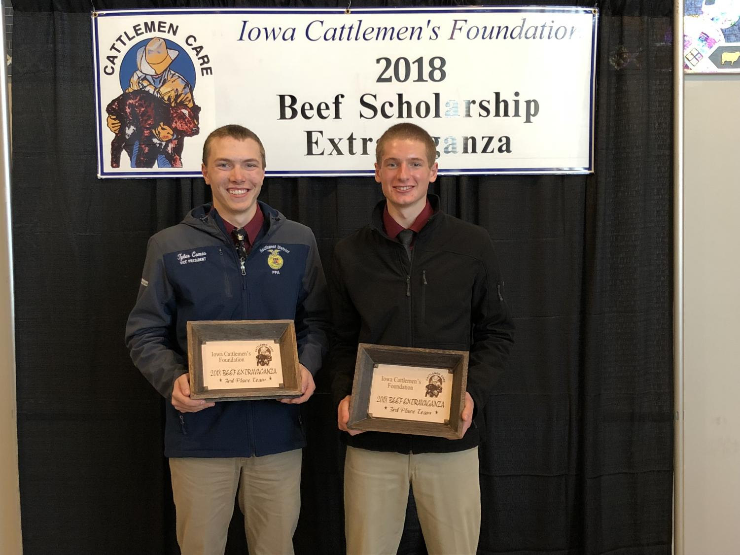 WIDE SMILES- Seniors Tyler Comes and Nathan Behrends proudly show their plaques from the contest. Comes and Behrends earned third place.