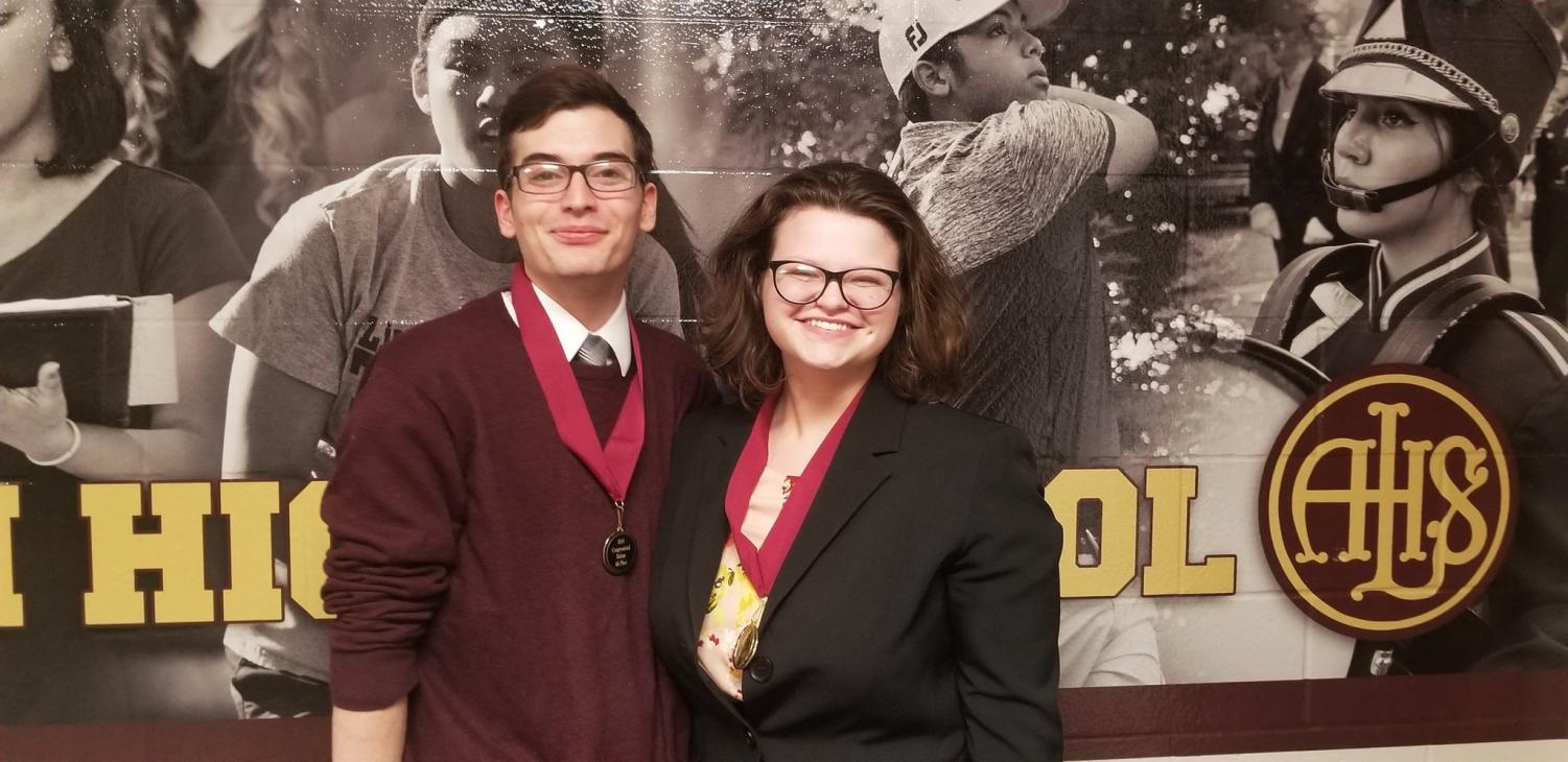 READY TO GO - Sophomore Troy Roach and senior Sarah Schorle smile following the results of a competition. Roach and Schorle have both competed in student congress and also perform a duo piece together.