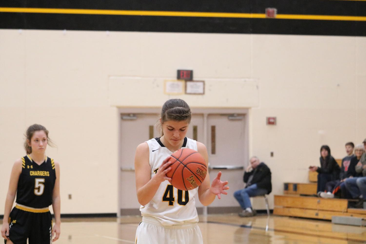 Senior Heidi Williams focuses before shooting a free throw in a scrimmage earlier this season. Against Harlan, Williams had nine boards and three steals.