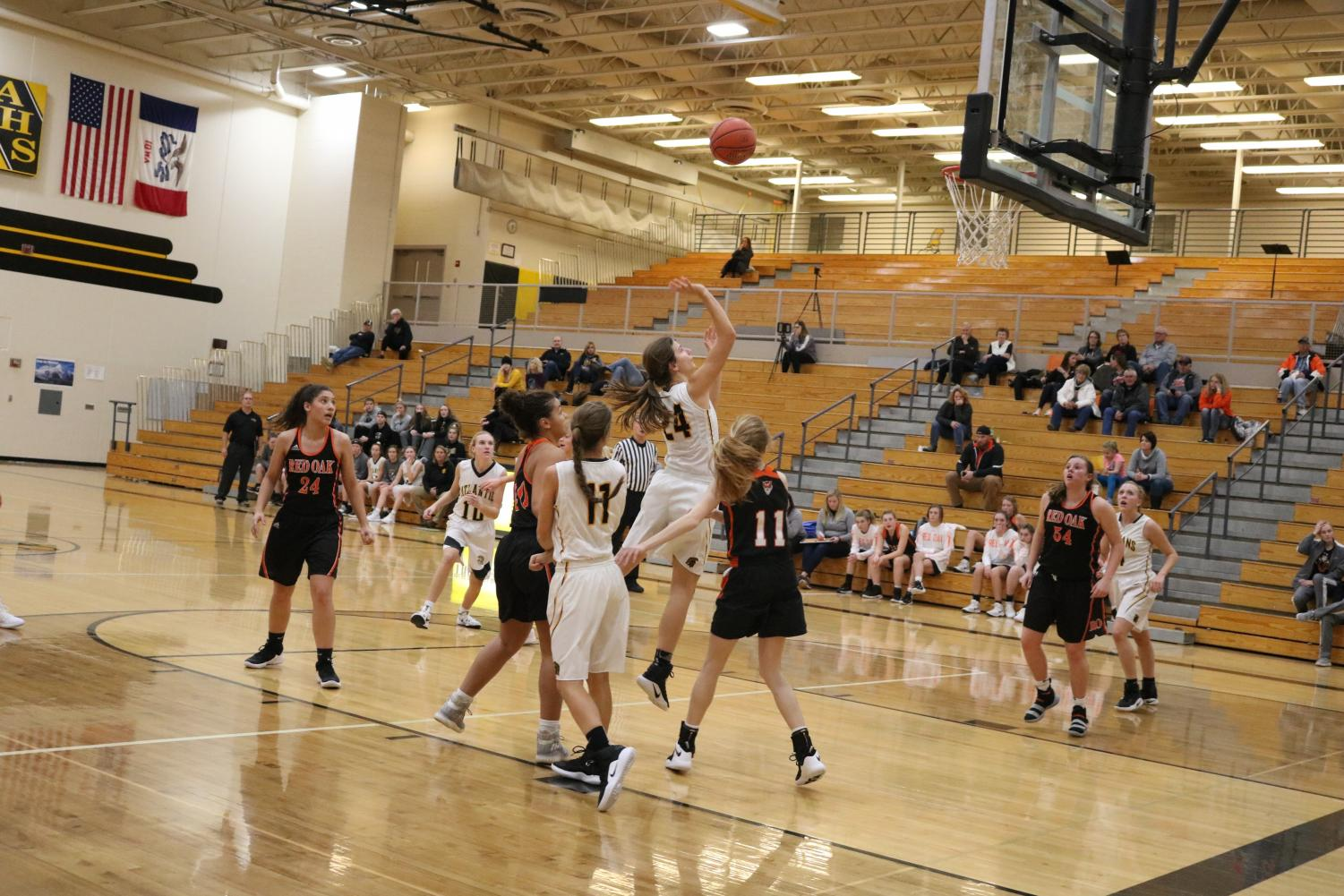 Sophomore Alyssa Derby goes up for two against Red Oak. In Friday night's varsity contest, Derby scored three points.