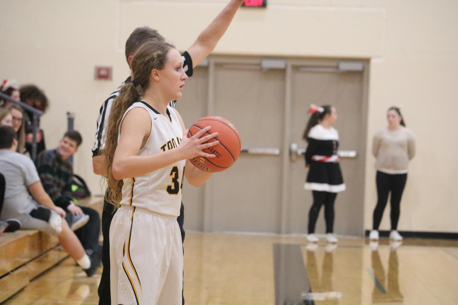 Junior Kenzie Waters prepares to inbound the ball to her teammates. In Friday night's contest, Waters put up six points.