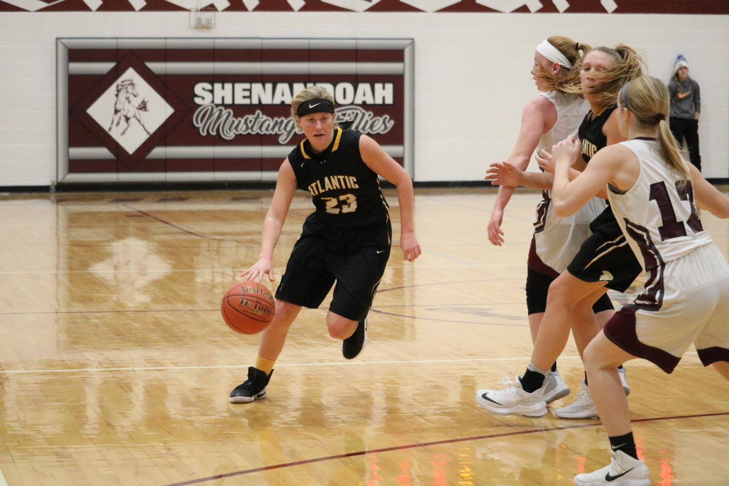 MAKING A MOVE- Senior Baylee Newell drives down the court during a game against the Shenandoah Fillies. Newell has been a member of the girls' basketball team all four years of her high school career.