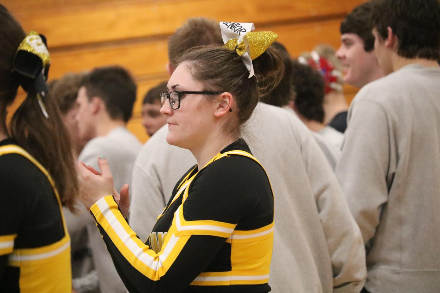 DOING WHAT I LOVE - Senior Chamilla Colton cheers during a wrestling meet. After being badly burned at just three years old, Colton was left with scars on her arms, chest and part of her face. She said she has used the experience to shape her into who she is today.