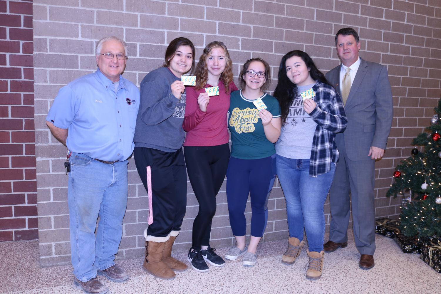 WE WON - Four of five winners of the gift cards smile with Randy Watts and superintendent Steve Barber. Winners included Cammey Klindt, Hannah Carlson, Dazia Sorensen, Lia Lillard and not-pictured was Trista Flathers.
