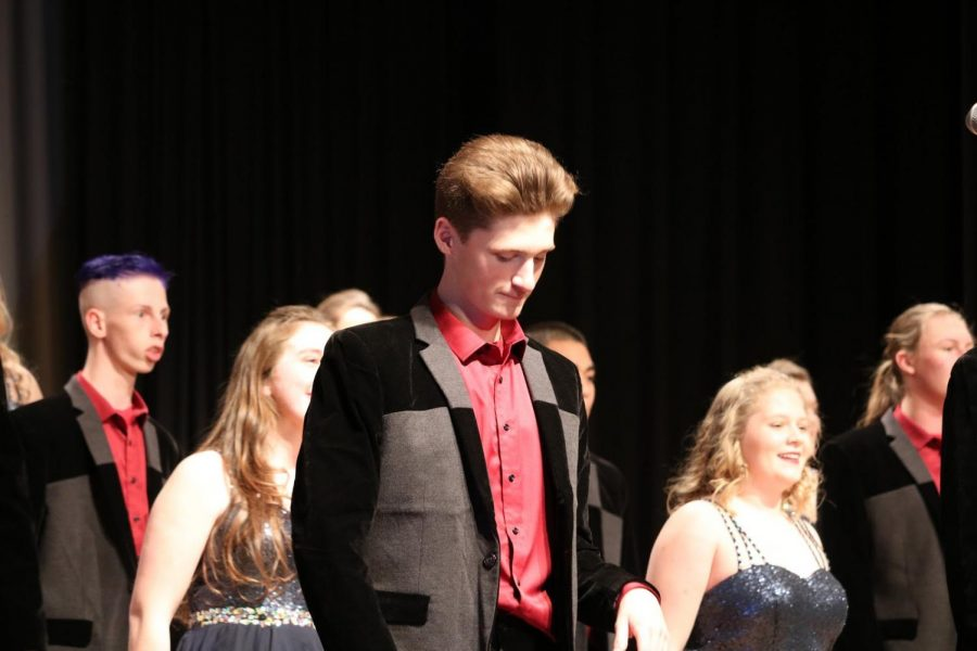 5, 6, 7, 8 - Junior Zachary McKay glances down after a song. McKay has been in show choir since his freshman year. His favorite part of show choir is going to the competitions.