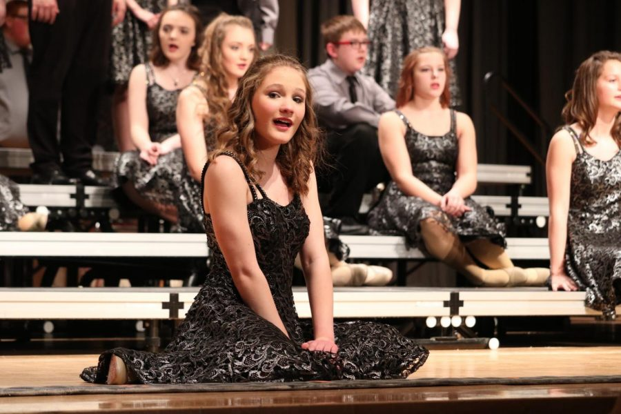 JUST KEEP SINGING - Freshman Katy Rothfusz, a member of Diversity, sings along during the ballad. A ballad is a song in a show choir performance where there is no dancing. Instead of moving to the beat, the music slows down as the performers create a still picture.