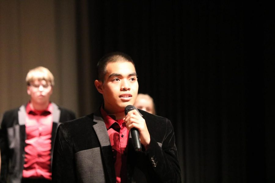"""NEVER ALONE - Senior Brainhart Buliche belts out a moving message during Premiere's show, titled Heros. With lyrics that said, """"I walk with you, so youre never alone,"""" the audience cheered as Buliche and the choir warmed everyone's hearts."""