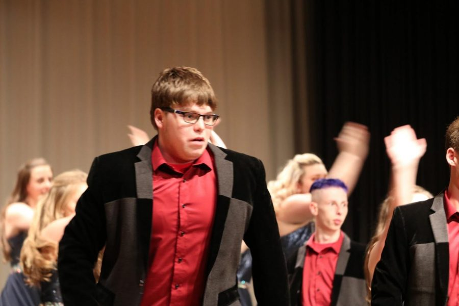 SHOWING EMOTION - Senior Avery Andersen gets into the music as he performs. Andersen has been in choir all four years of high school and is known for his perfect pitch.