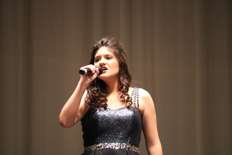 """HOLDING OUT FOR A HERO - Genevieve Martinez belts out a solo to start the girls number. """"I like working with my friends and making choir a positive environment. The high energy it brings allows my friends and I to have fun while performing,"""" Martinez said."""