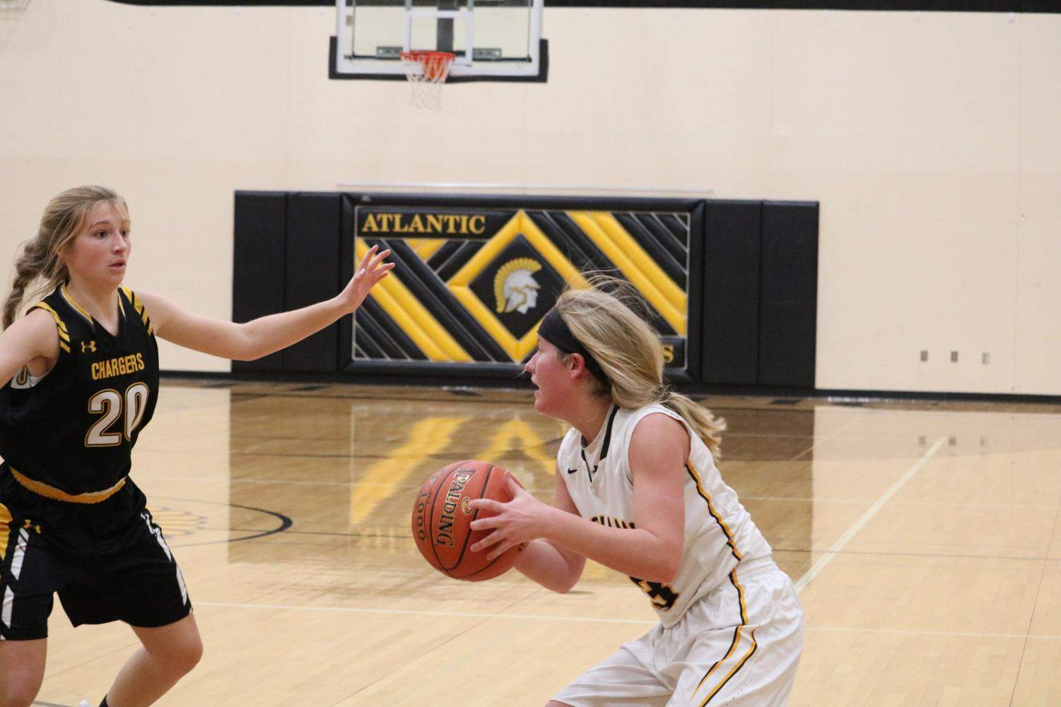 Senior Baylee Newell grips the ball on offense. Against the Cyclones, Newell netted two points and had five steals.