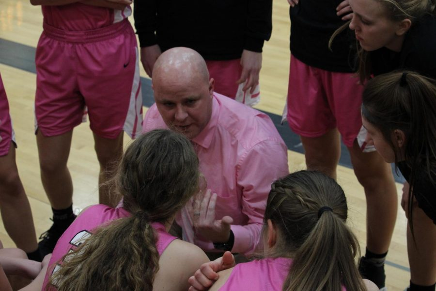 Coach+Dan+Vargason+strategizes+with+his+team+during+the+Pink+Out+game.+The+girls%27+pink+jerseys+were+made+specifically+for+this+game.