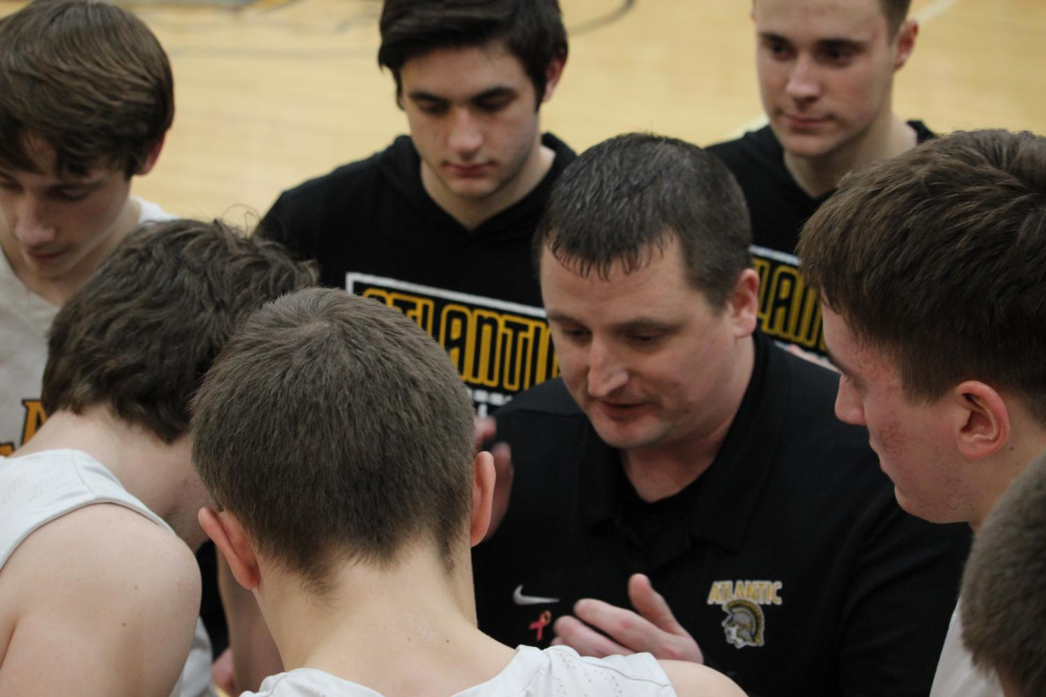 Atlantic head boys' basketball coach Jeff Ebling breaks down a play during a timeout. The regular season ends for the Trojan boys on Thursday, as they play Denison-Schleswig at home.