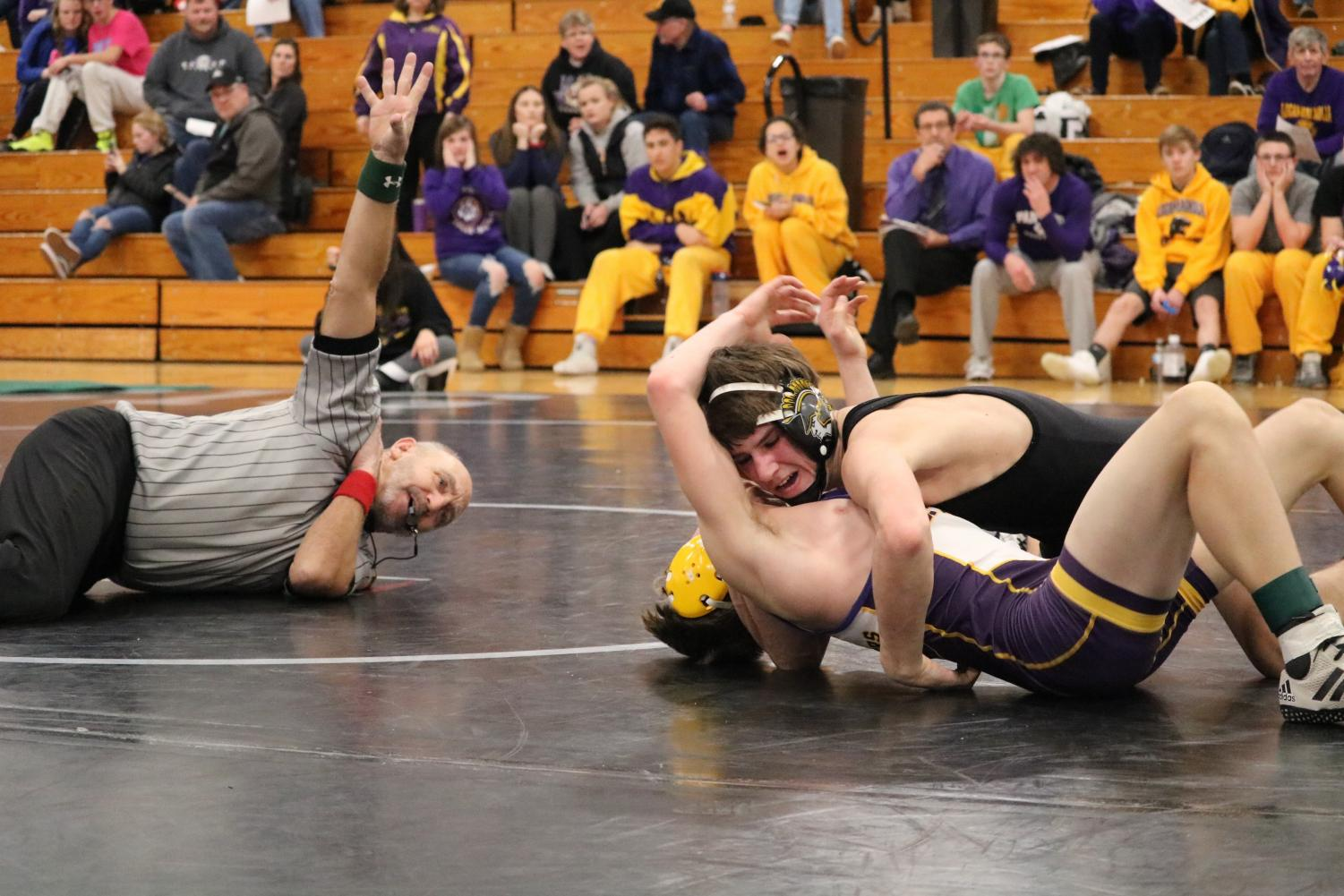 FIGHT UNTIL THE WHISTLE - Sophomore Joe Weaver competes in a tough match at the OA-BCIG tournament earlier in the season. Weaver, wrestling at 120, is one of the six Trojans advancing to districts.