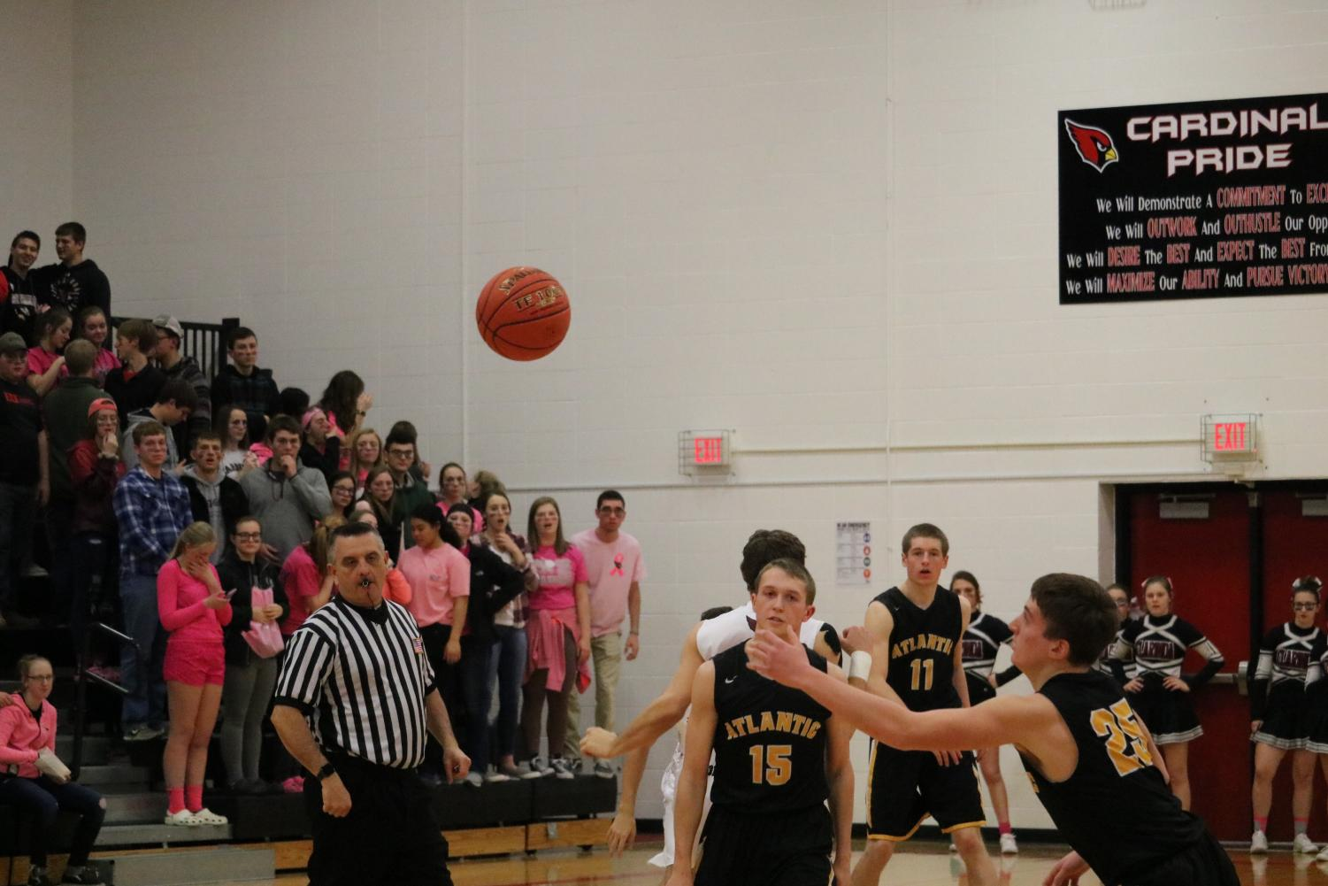 Senior Logan Reilly reaches toward the ball after tip-off against the Cardinals earlier in the season. Against Clarinda, Reilly had two rebounds and two steals.