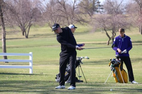 Senior Matt Gearheart watches his shot. Gearheart has medaled four times so far this season.