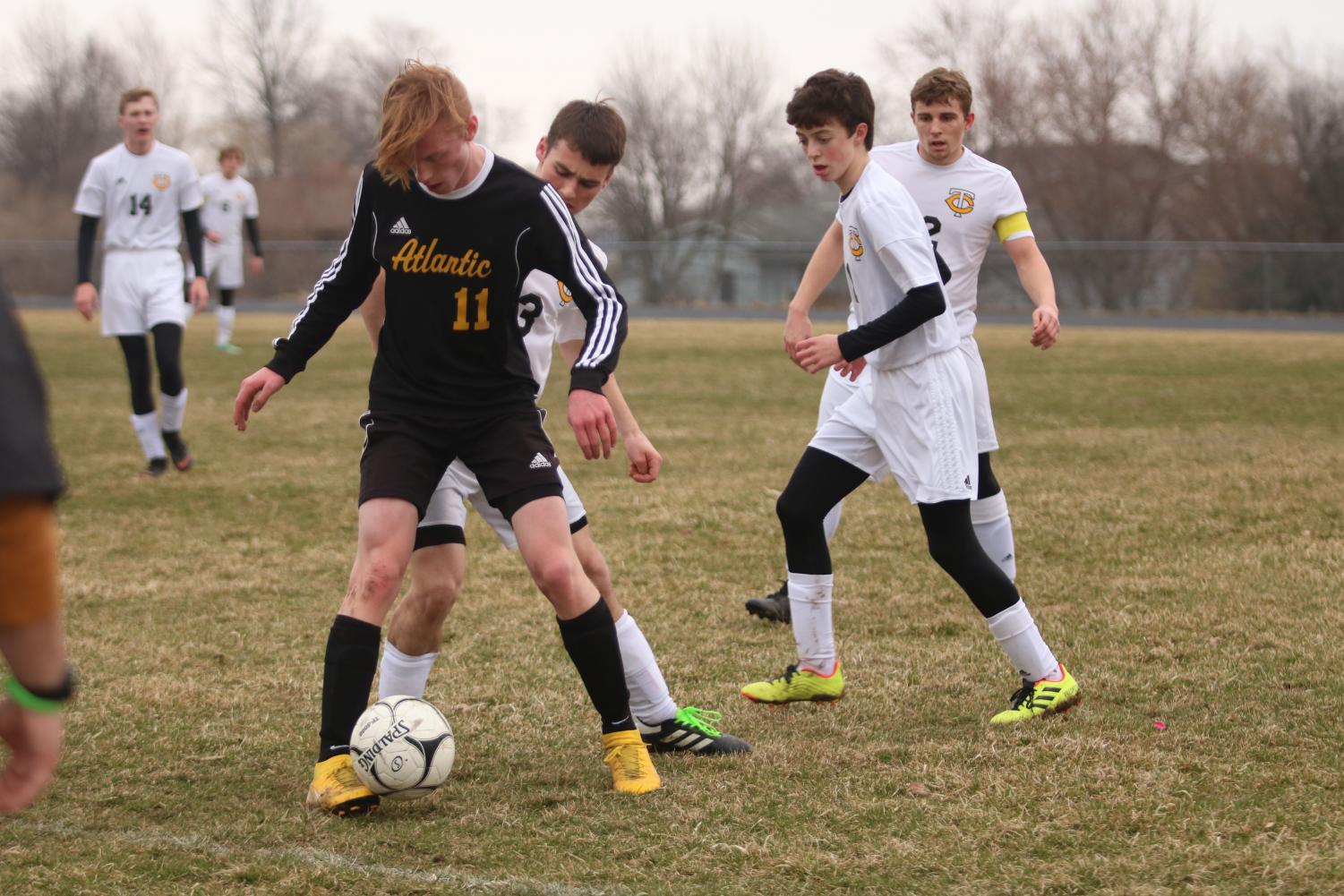 BACK OFF - Junior Ben Andersen shields the ball from a Tri-Center competitor. Andersen has been a key player for the Trojans throughout the season.