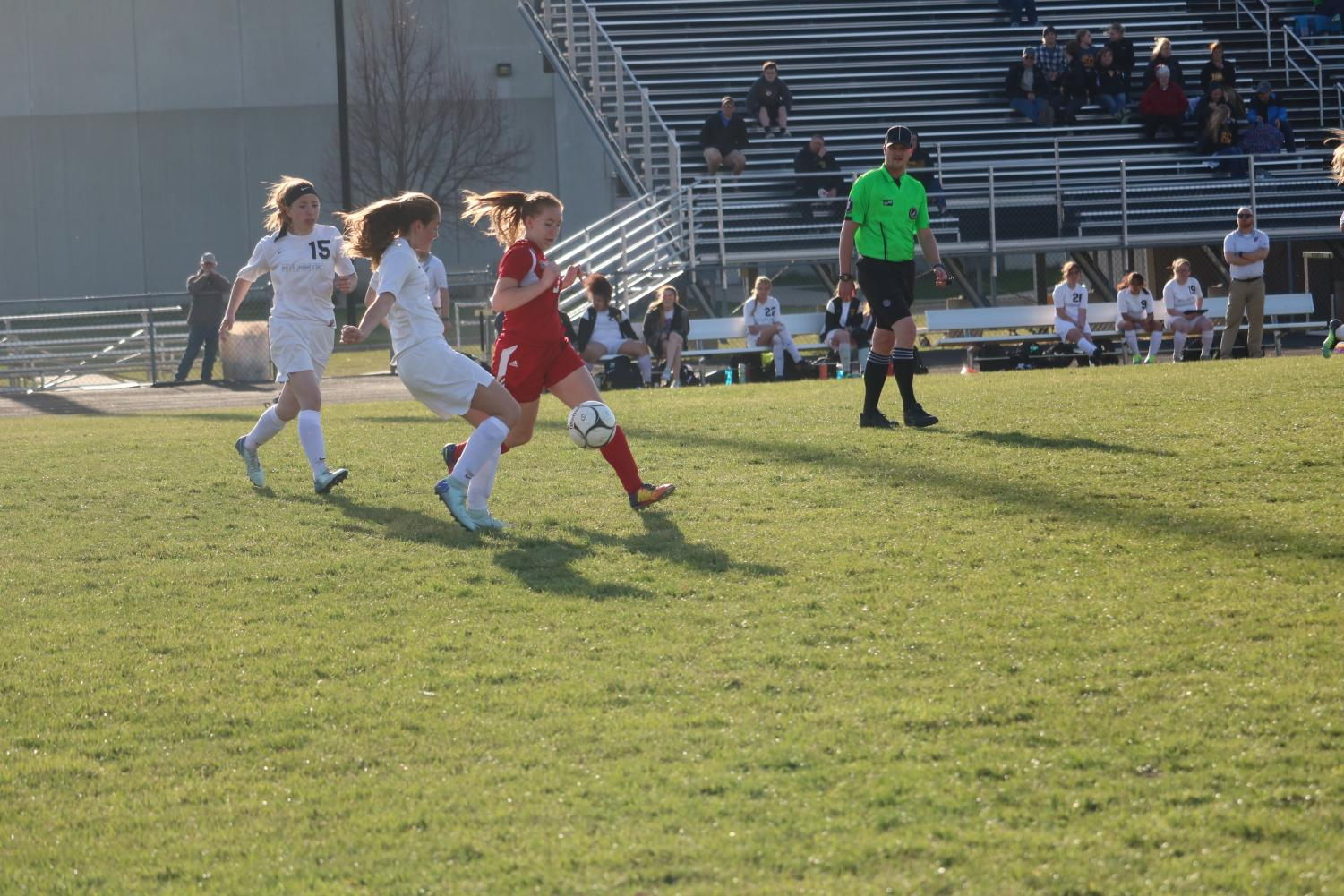GOING FOR THE SAVE -- Sophomore Lauren Nicholas runs after the ball in the game against Harlan last year. Nicholas did not return this year.